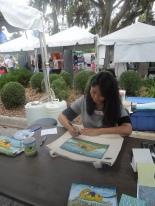 Artist Kana Handel autographing her inspiring work.